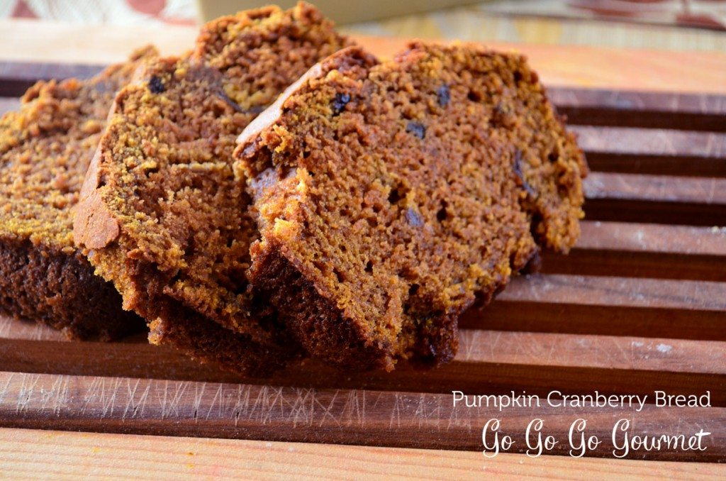 This pumpkin bread is flavored with citrus and studded with cranberry, for a truly unique fall treat! | Go Go Go Gourmet