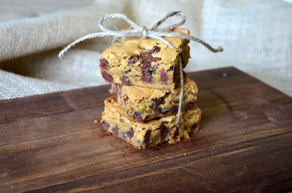 Chocolate chip blondies stacked on a board
