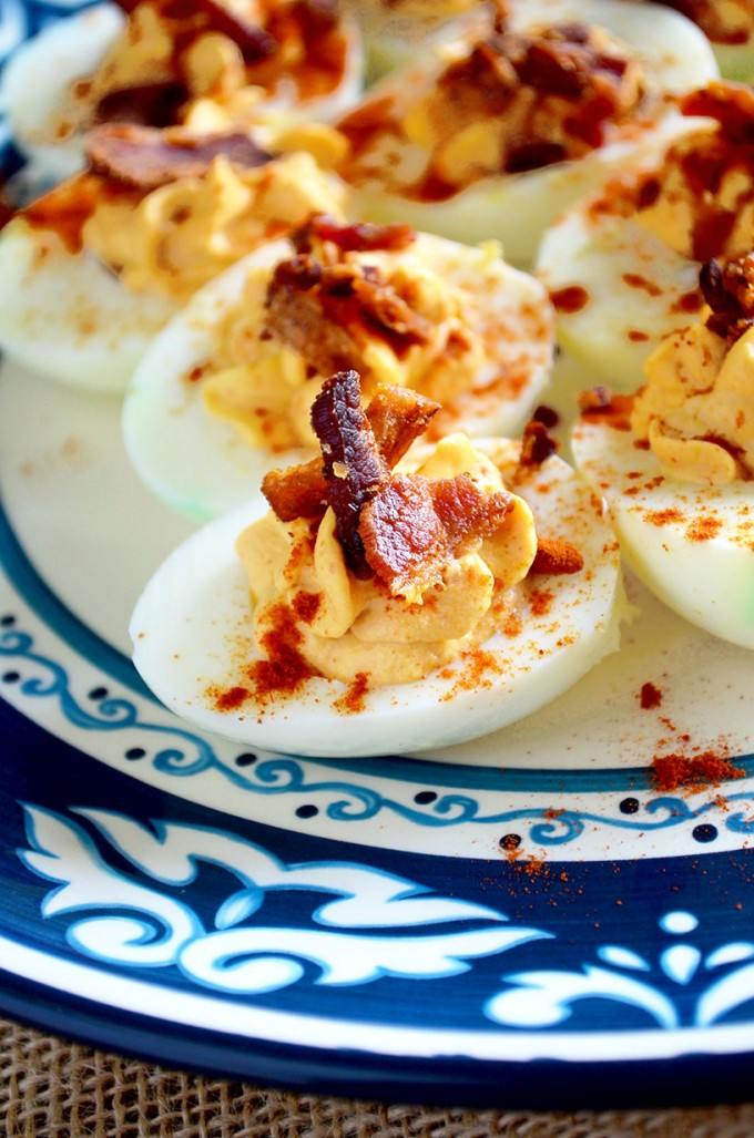 Boiled egg recipes - bacon sriracha deviled eggs on a blue plate