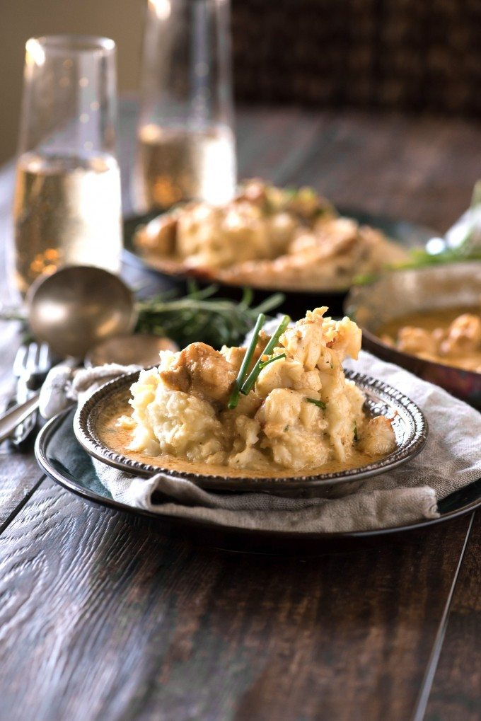 Lobster mashed potatoes in a bowl with herbs