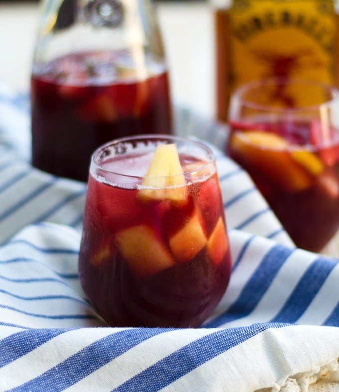 Thanksgiving recipes, fireball sangria in a glass on a white and blue towel