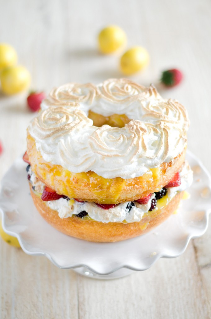 Angel Food Cake With Lemon Curd Fresh Berries And Meringue Rosettes