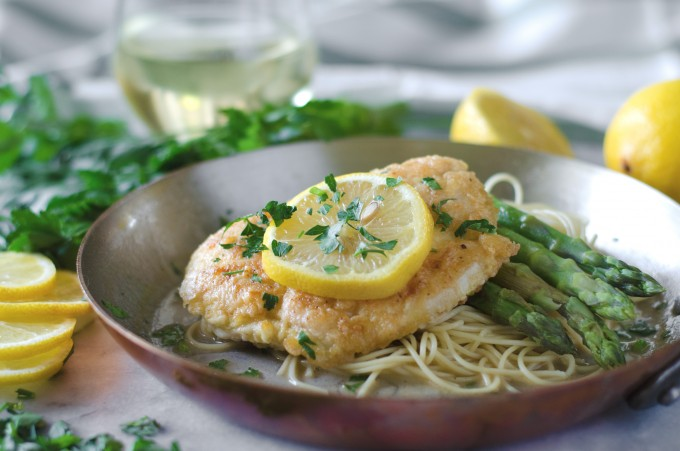 Chicken Francese recipe in copper skillet on marble board