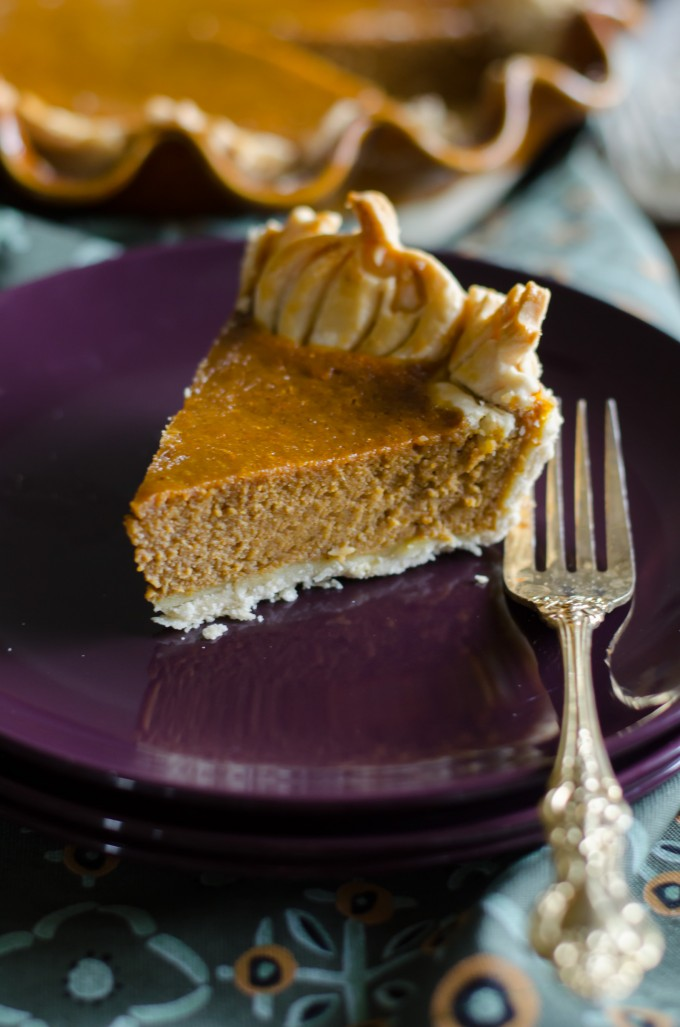 Slice of pumpkin chiffon pie on a purple plate