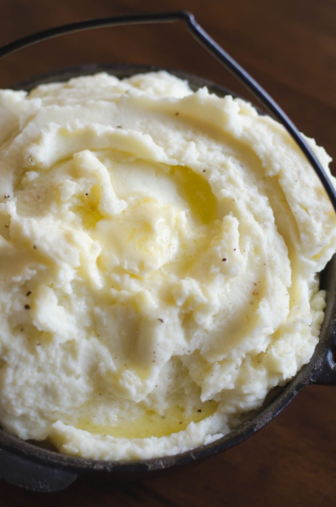 Whipped potatoes topped with butter in a bowl as thanksgiving recipes