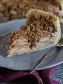 Thanksgiving recipes, slice of deep dish apple pie on a plate