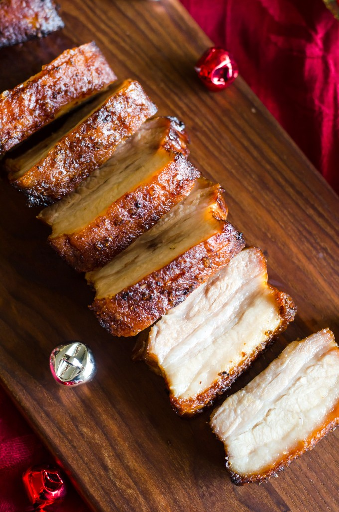 This Crispy Pork Belly recipe is marinated in Asian flavors, then roasted with a salt crust for crispy skin and tender meat. No scoring required! | @gogogogourmet