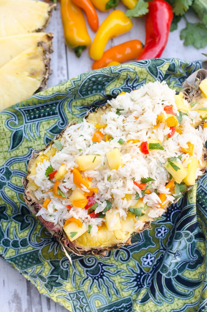 This easy Tropical Pineapple Rice puts a twist on the classic Chipotle cilantro rice! Perfect for any weeknight meals, you can even serve it in a pineapple bowl for fun! It would taste great with any Thai or Hawaiian chicken recipes, and makes a great healthy side dish! #gogogogourmet #pineapplerice #cilantrorice #tropicalpineapplecilantrorice
