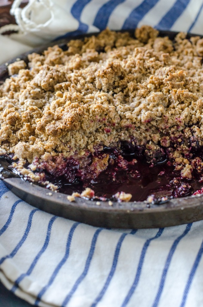 Close up of blueberry crisp recipe in a skillet