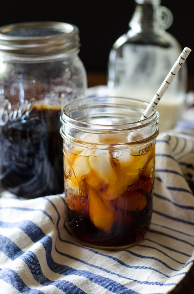 A mason jar with cold brew coffee and a straw