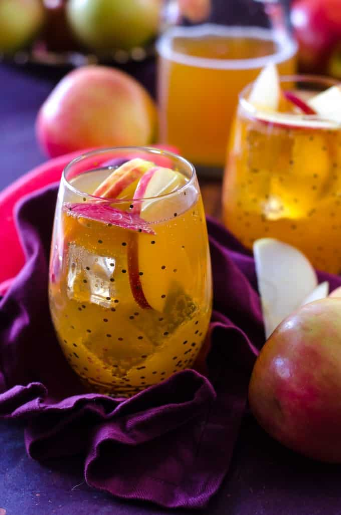 Thanksgiving recipes, apple cider fireball sangria in a polka dot glass with apples