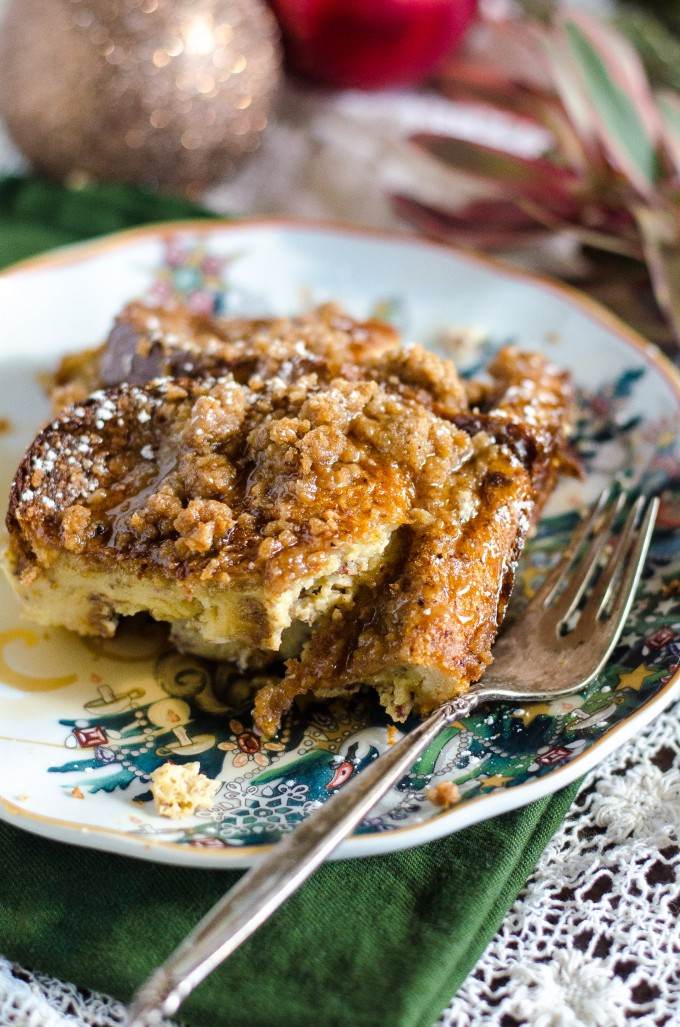 Eggnog french toast casserole cut into a slice on a plate