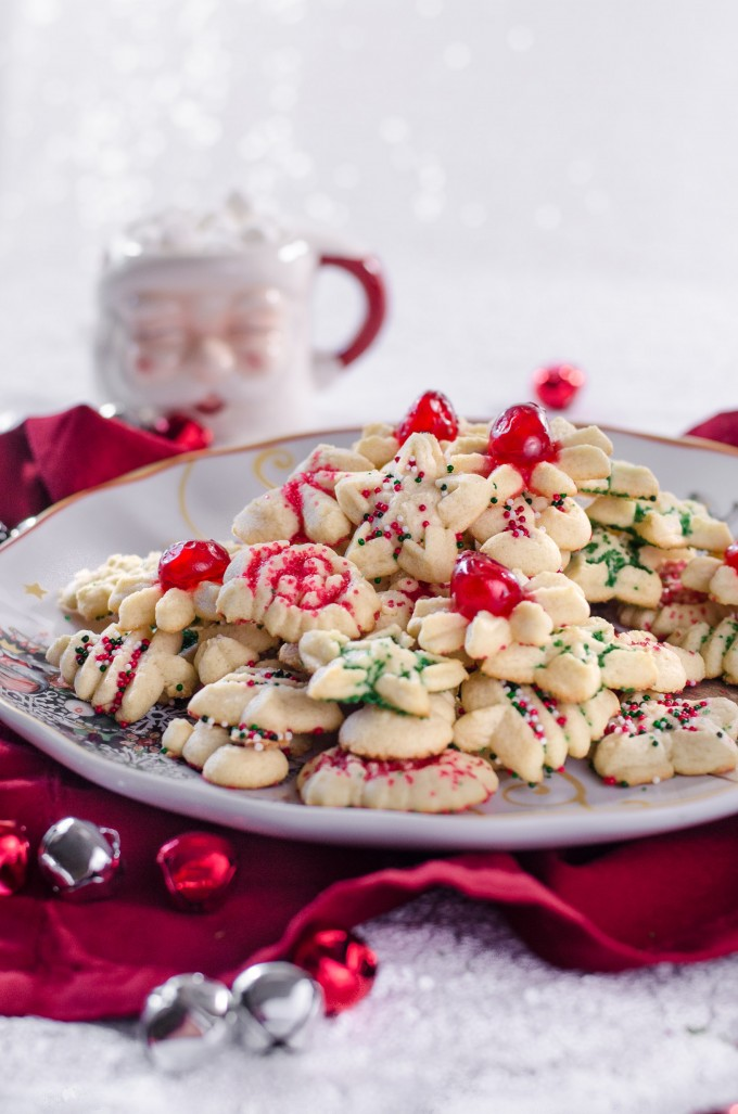 Spritz cookies on a white plate - christmas desserts