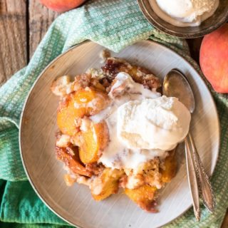 Slow Cooker Peach Cobbler Cake is the best and easiest way to use up summer's amazing peaches. No oven required! | @gogogoggourmet