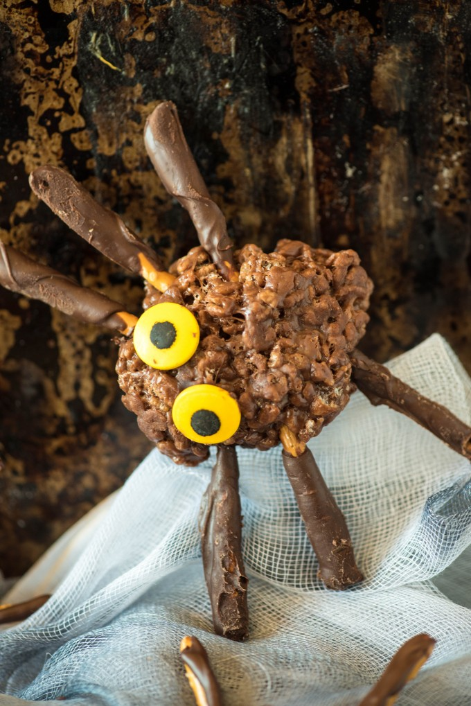Chocolate peanut butter rice krispie treat spider with yellow eyes