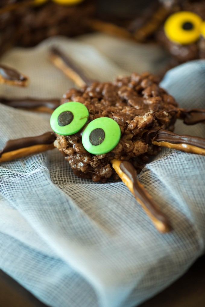 Chocolate peanut butter crispy treats spider with green eyes on a cloth