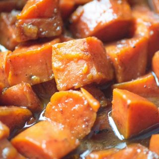 Candied sweet potatoes in a baking pan