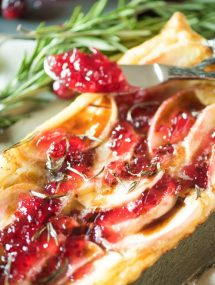 Apple brie puff pastry tart with a knife as thanksgiving sides