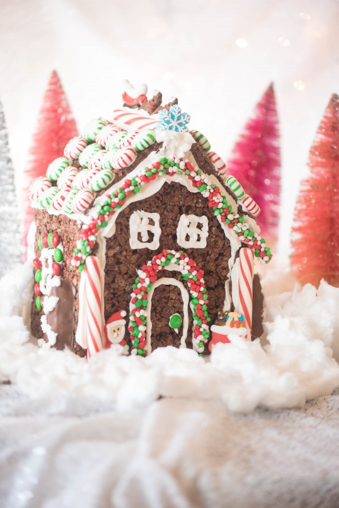 Rice krispie treat gingerbread house on fake snow - christmas desserts
