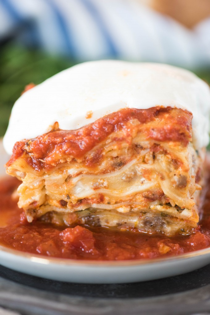 slice of easy lasagna recipe on white plate topped with mozzarella