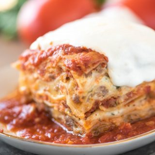 Easy lasagna recipe full of sausage, ricotta, and mozzarella