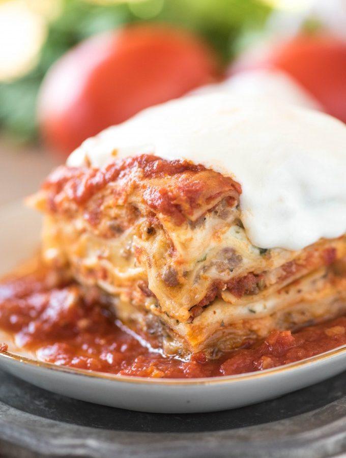 Easy lasagna recipe full of sausage, ricotta, and mozzarella