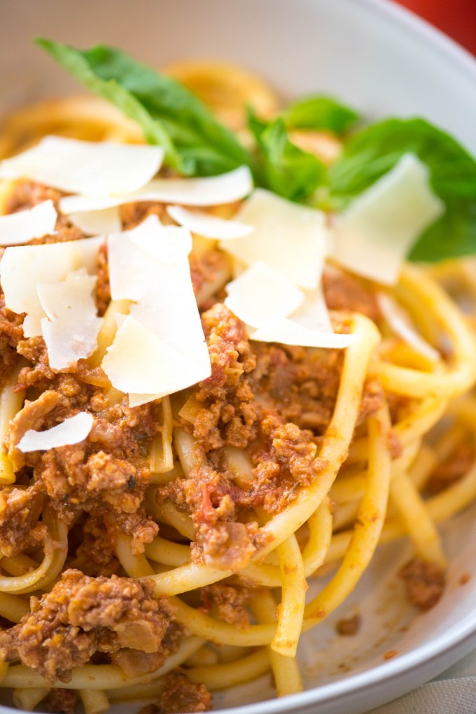 spaghetti bolognese with shaved parmesan