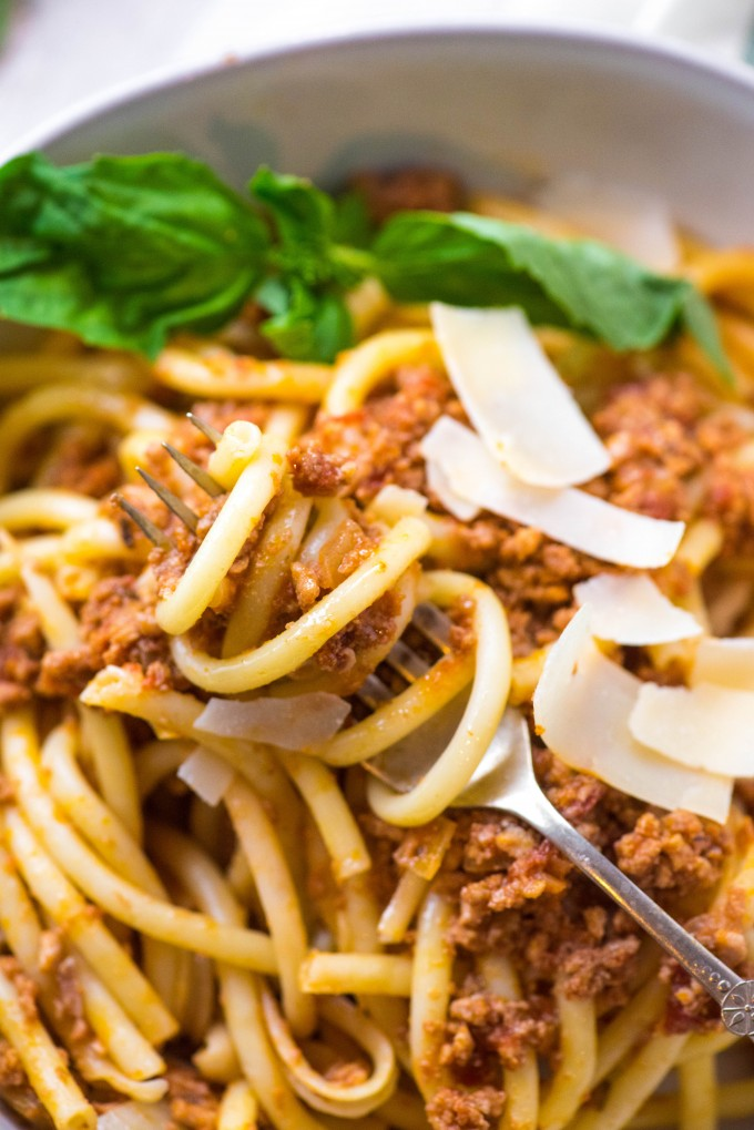 Slow Cooker Bolognese Sauce on spaghetti on fork in bowl