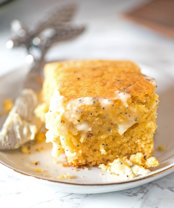 Honey cornbread on white plate with honey poppyseed butter