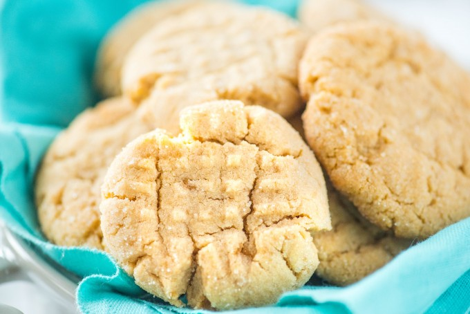 Chewy homemade peanut butter cookies on blue napkin in bowl