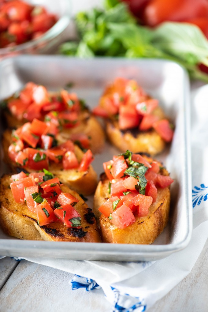Easy tomato bruschetta with basil on baguette slices - new years eve party food