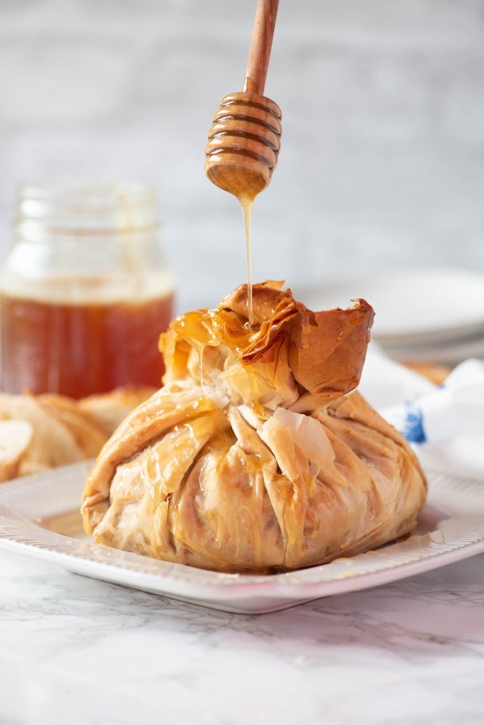 Baklava Baked Brie Appetizer drizzled with honey