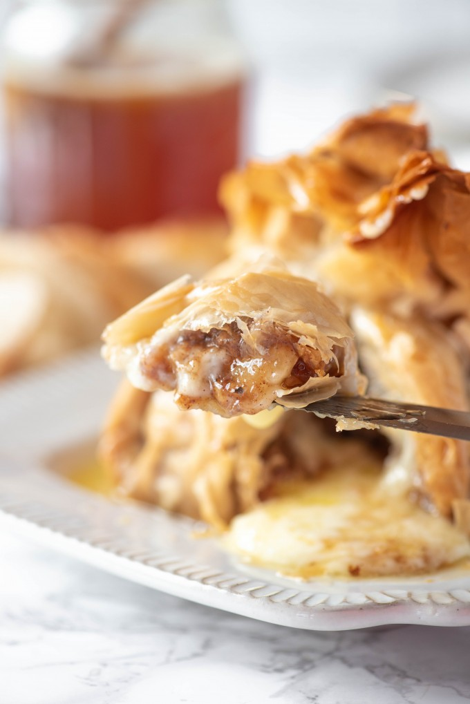 Cut baked brie with baklava filling