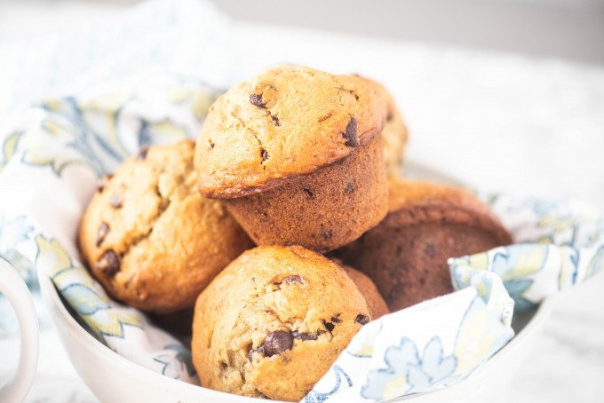 A basket full of the best banana chocolate chip muffins