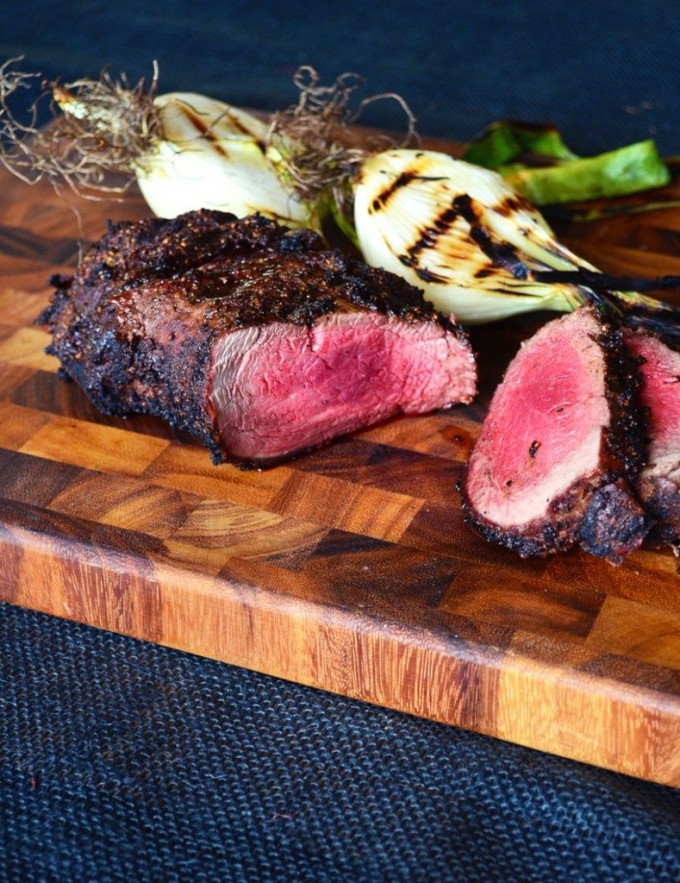 Grilled beef tenderloin on a cutting board