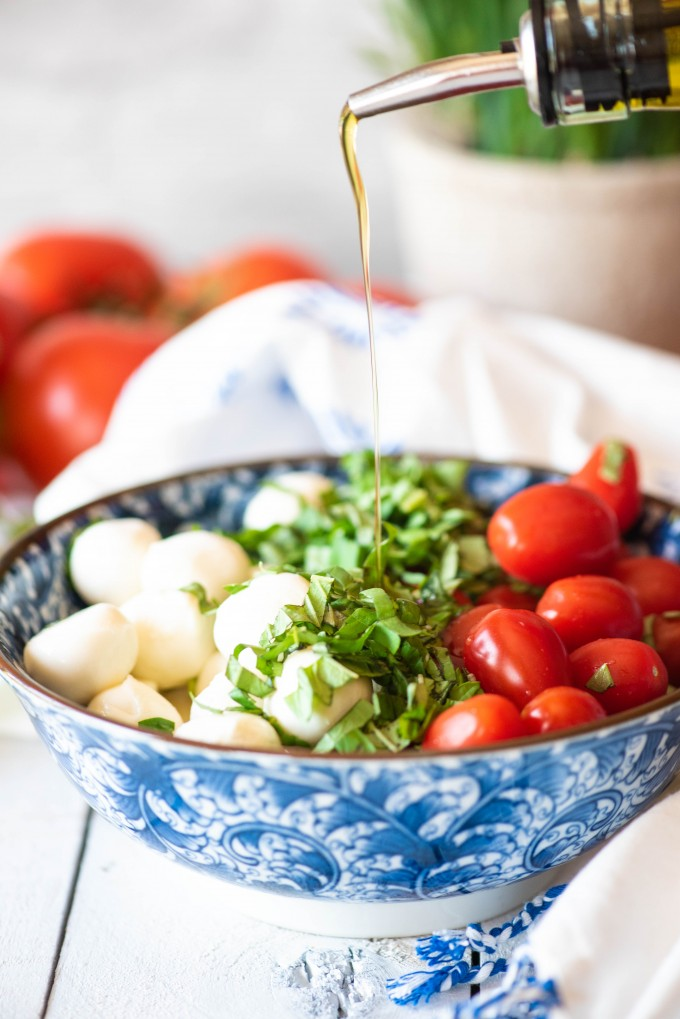 Bobboncino caprese salad ingredients in a bowl