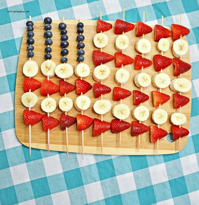 Red white and blue fruit skewers on a tray