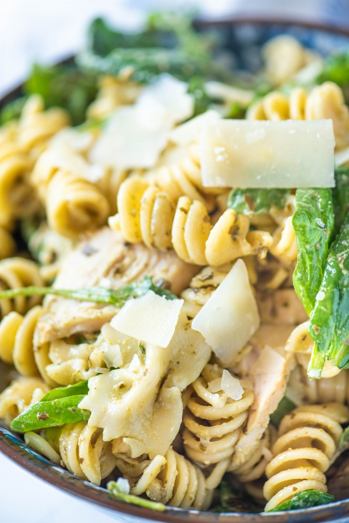 Close up of pesto pasta salad in a blue bowl