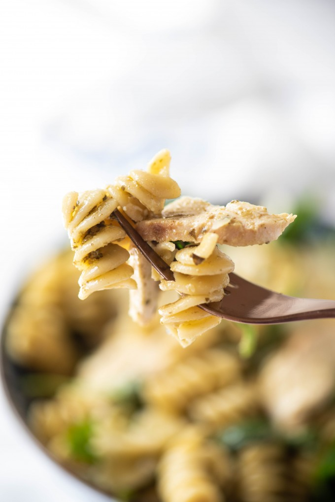 A fork full of pesto pasta salad