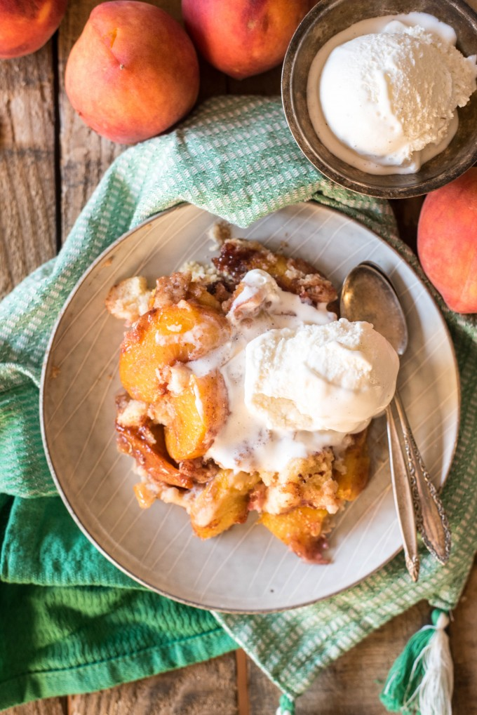 Peach cobbler cake with a scoop of ice cream