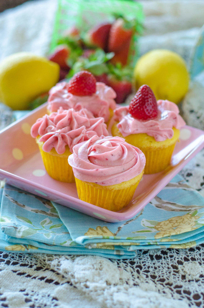 Strawberry lemonade cupcakes on a pink plate