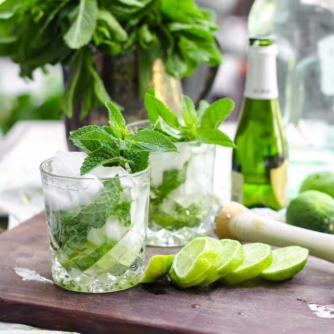 Two champagne mojitos with cut lime