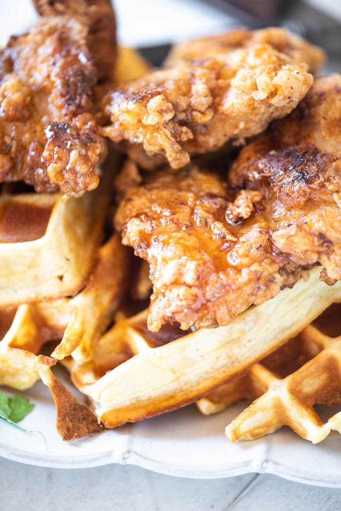 Sriracha honey drizzled on Chicken and Waffles