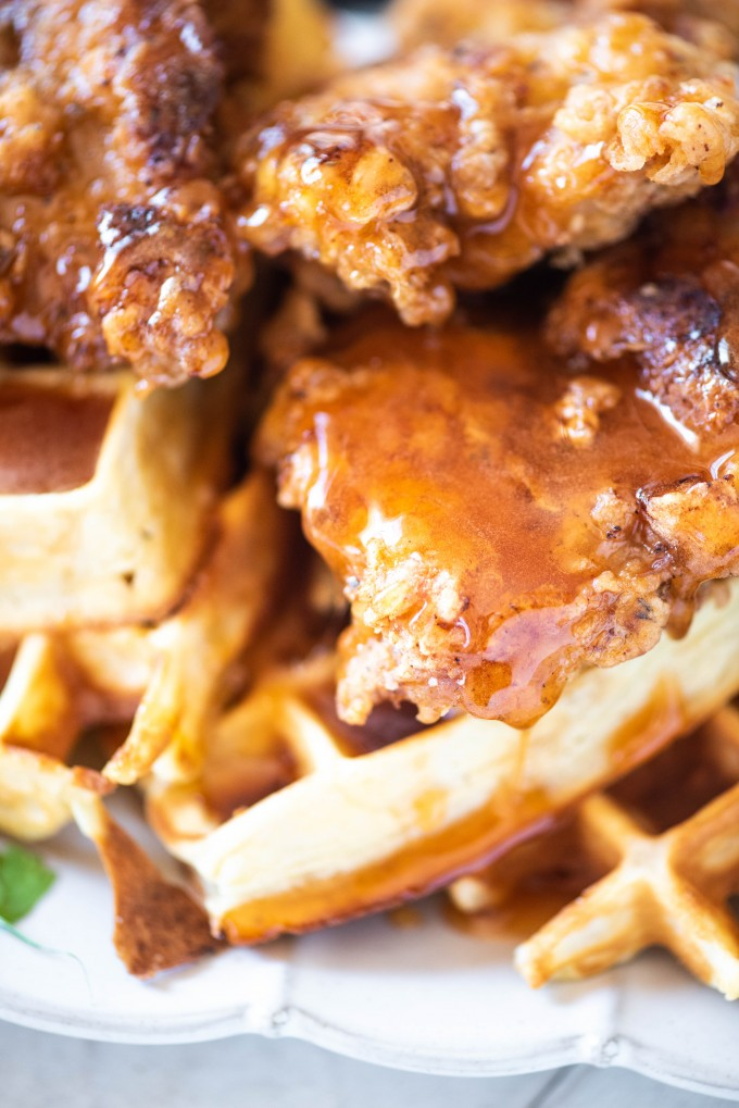 Spicy fried chicken thighs on waffles