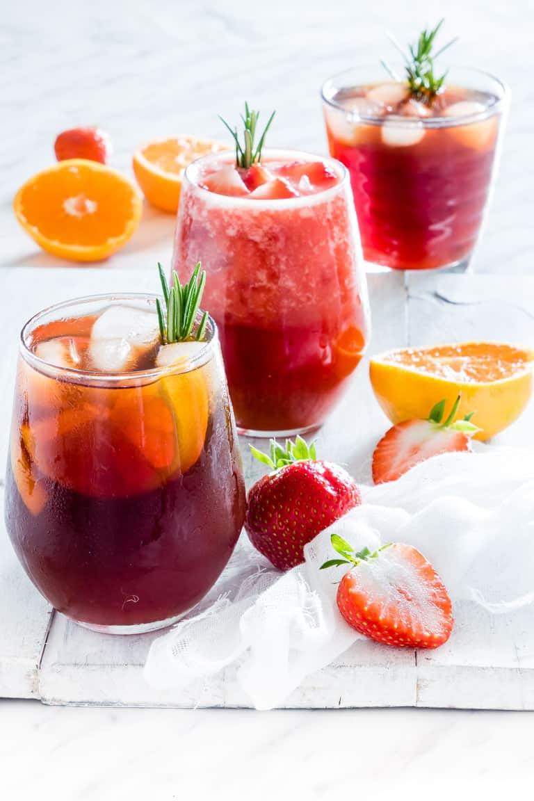 Three glasses of Instant Pot iced tea with oranges and strawberries