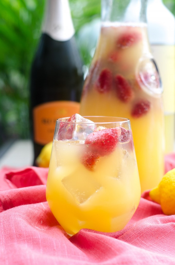 A glass of limoncello sangria with strawberries
