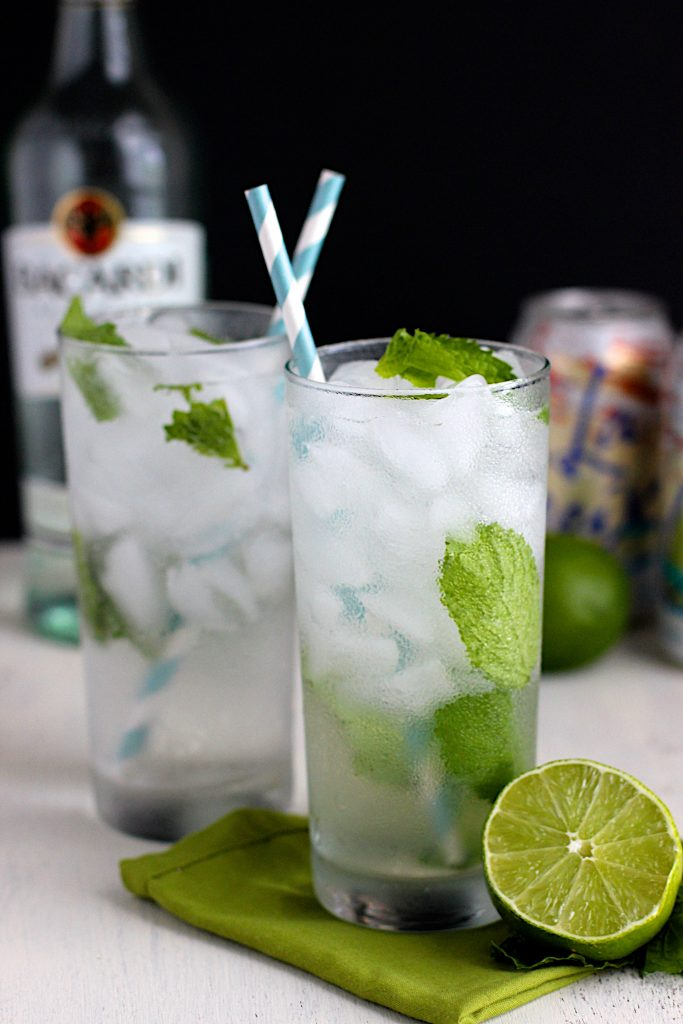 Two coconut mojitos with straws