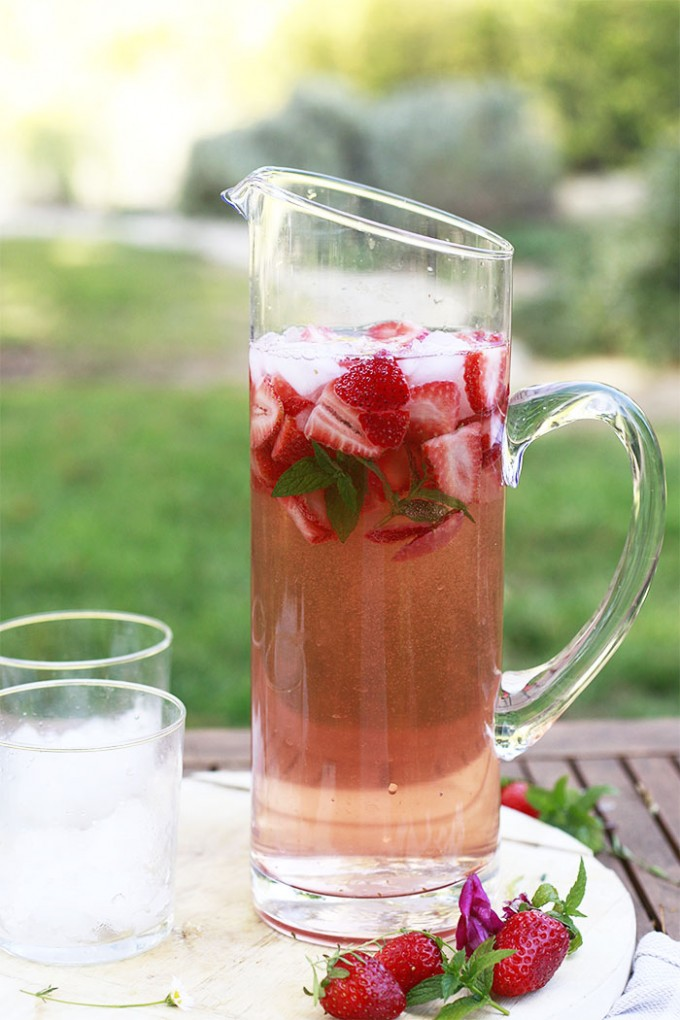 Tall pitcher of rose sangria with two glasses