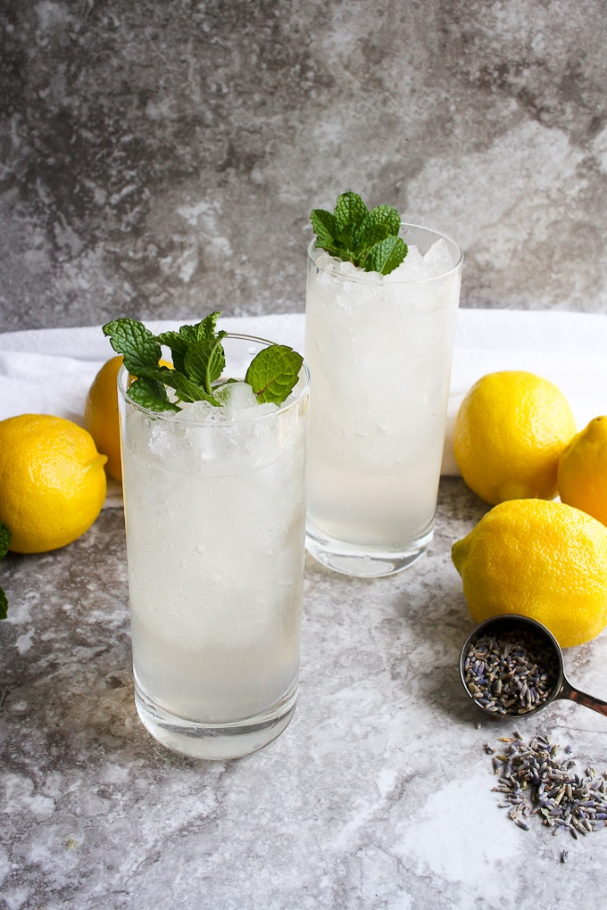 2 glasses of lavender lemonade with lemons