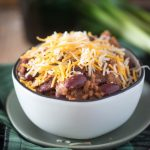 Instant pot chili topped with cheese in a white bowl